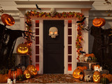halloween decorated house with pumpkins and skulls. 3d rendering - 177503171