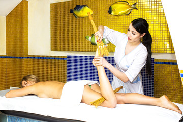 Japanese massage with bamboo sticks in spa salon
