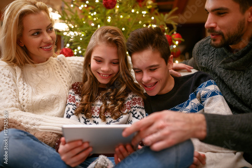Children with parents on Christmas holiday having fun