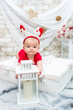 little cute baby girl on Christmas Eve holding a decorative lantern