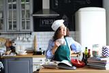Beautiful woman preparing food in the kitchen - 177533516