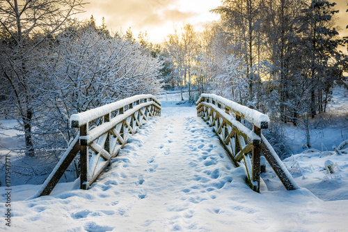 Snowy, wooden bridge in a winter day. Stare Juchy, Poland