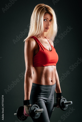 Athletic Girl Holding Dumbbells Poster