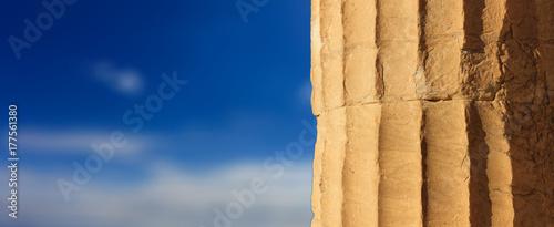 Greek marble pillar detail on blue sky background