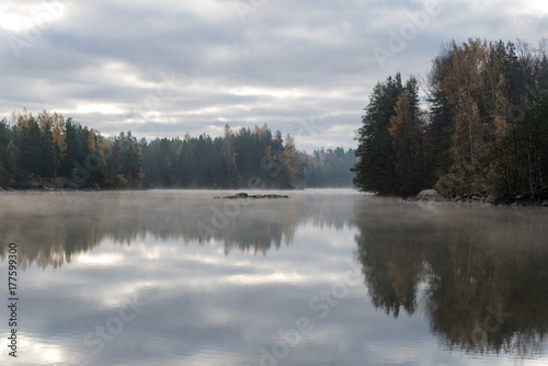 Calm lake in misty morning. - 177599300
