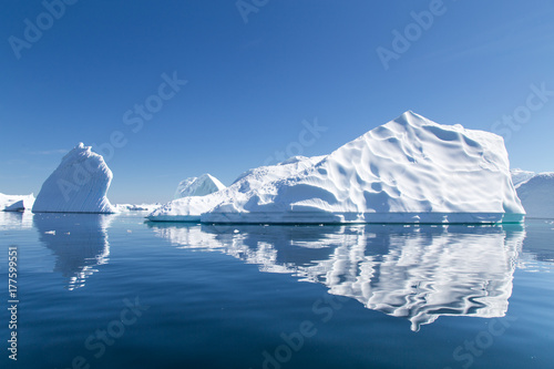 Fotobehang Antarctica Icebergs reflect in the water in Pleneau Bay, Antarctica