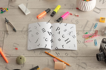 Open notebook with letters on it