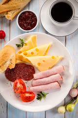Breakfast - sausages, yellow cheese and vegetables
