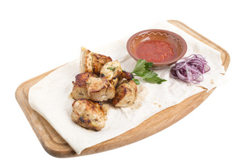 Sliced grilled chicken with tomato sauce.