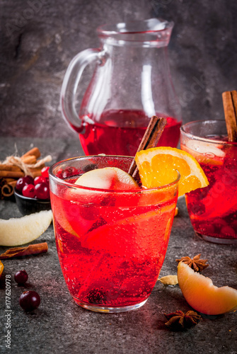 Poster Fall and winter cold drinks, cranberry and orange holiday christmas punch with c