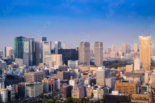 Aerial skyscraper view of office building and downtown and cityscapes of Tokyo city with blue sly and clouds background Poster