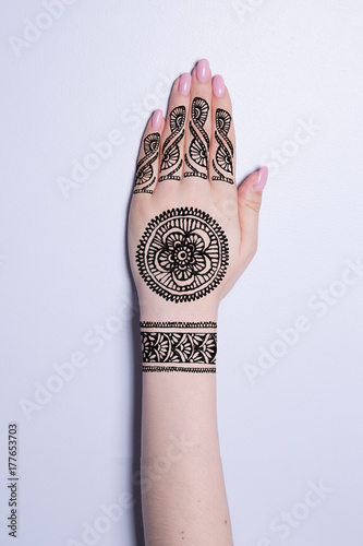 hand with mandala pattern tattoo henna mehendi Poster