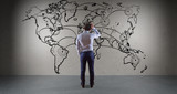 Businessman watching manuscript world map connection on a wall 3D rendering