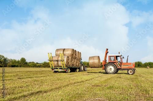 Aluminium Trekker Agricultural scene. Tractor lifting hay bale on barrow.