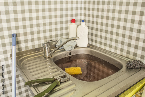 The clogged kitchen sink. Clogged pipes. Problems with the water ...