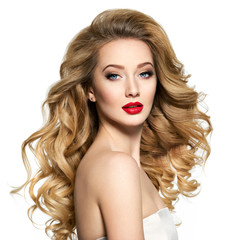 Pretty woman with long hair and red lips.