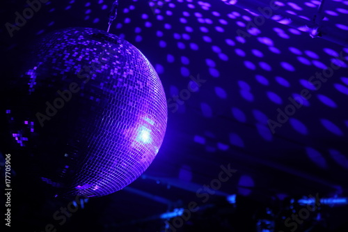 Fototapeta Disco ball with bright rays, night party background photo.