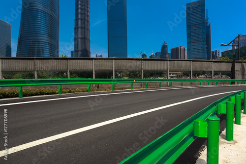 Empty road surface with shanghai landmark buildings backgrounds Poster