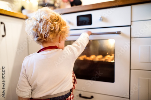 Young family making cookies at home. Poster