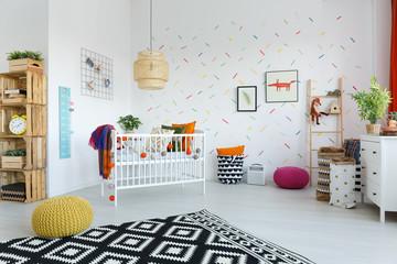Spacious scandi bedroom with cradle
