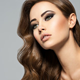 Face of a beautiful  woman with long brown  hair - 177736772