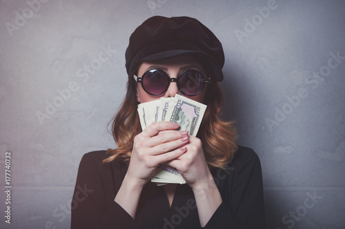 Style redhead girl in black hat and clothes with money Poster