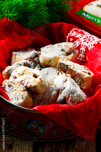 Christmas Stollen coockies on a Christmas rustic background Poster