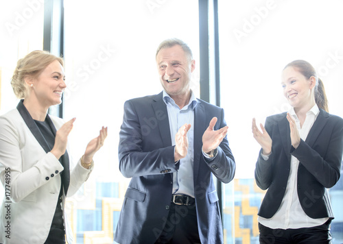 Sticker Business group clapping and smiling