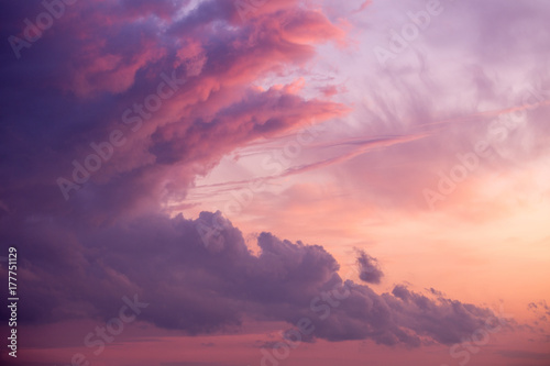 Aluminium Dramatic and scenic cloudy sunset or sunrise sky . Purple fiery lights. Wallpaper or background