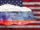 American flag and Russian flag painted on a brick wall.  - 177761178