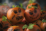 tangerines ornamented as carved pumpkins - 177768903