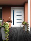 Modern stone house entrance white door - 177772304