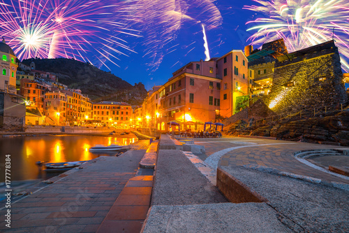 New Years firework display over Riomaggiore town, Italy Poster