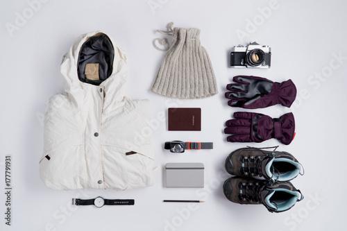 Flat lay of Traveler's accessories in winter season