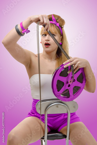 sexy pin-up girl with a film reel Poster
