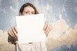 Woman holding white blank paper
