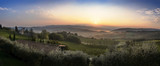 Beautiful sunrise with some fog between the hills with vineyards in Tuscany in Italy