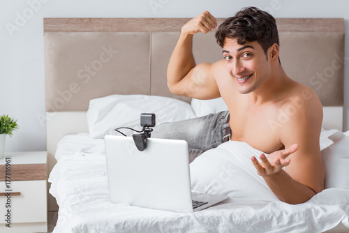 Young sexy man in online dating concept