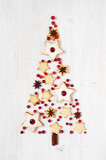 Shape of Christmas tree of traditional Linzer cookies with red jam - 177829343