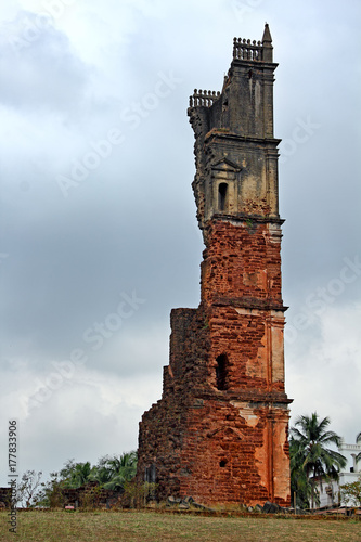Ruins of 46 meter high belfry of the Church of St Augustine in Old Goa, India Poster