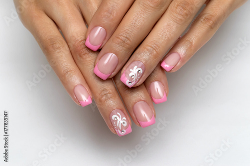 Aluminium Manicure French pink manicure with crystals and monograms on nameless nails on short square nails