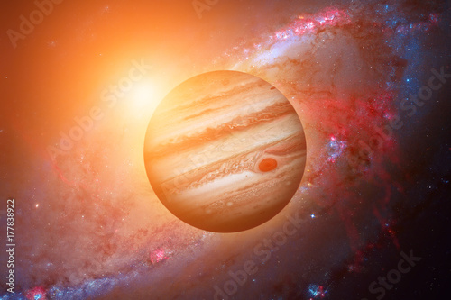 Planet Jupiter. Galaxy on the background.