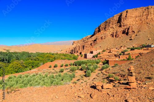 Fototapeta Landscape of a typical moroccan berber village with oasis in the valley