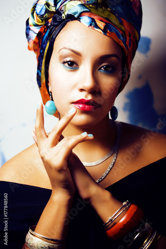 beauty bright african woman with creative make up, shawl on head Poster
