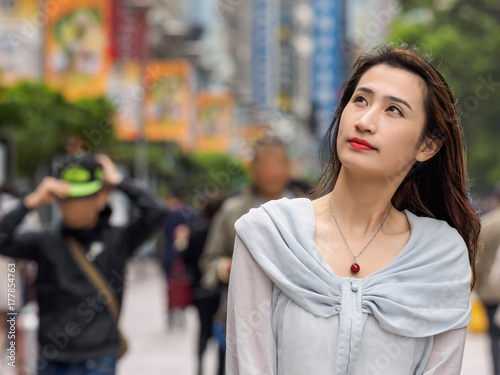 Beautiful woman walking on Nanjing road in Shanghai. Poster