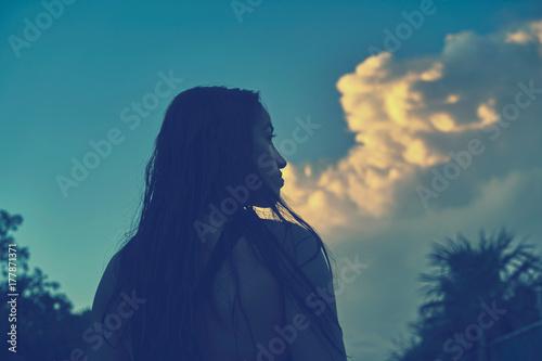 Aluminium Palm boom Sunset sky with beautiful girl rear view