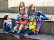 Group of children portrait with ball and skateboard - 177882593