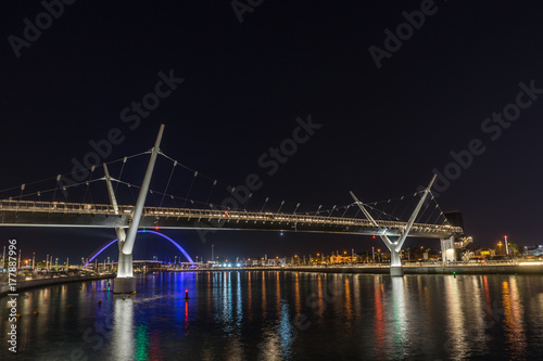 Pedrestrian bridge over Dubai Water Canal at night Poster