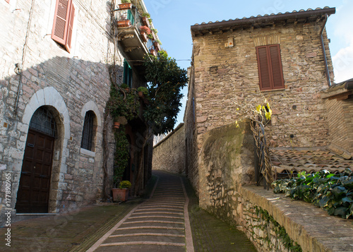Poster Smal steegje A stone staircase leads up through the quiet historic streets of Assisi, Umbria, Italy