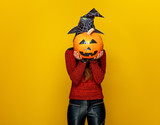 Woman Holding Sad Jackolantern Pumpkin In Front Of Face Wall Sticker